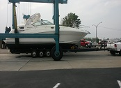Boat that is being loaded onto a trailer